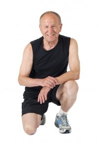 Fit senior man smiles after exercises